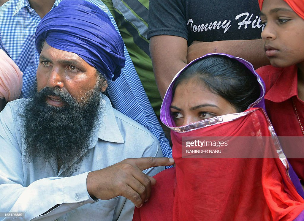 Harbrinder kaur, 25, along with her father ex-serviceman Kashmir Singh (L), address journalists during a protest against Punjab Police and the state government at Usman village near Tarn Taran district about 25 kms(15 miles) from Amritsar on March 5, 2013. Kaur and her father claim they were assaulted by four policemen when they approached them to register a case against truck drivers, for allegedly passing lewd remarks and attempting to molest her.