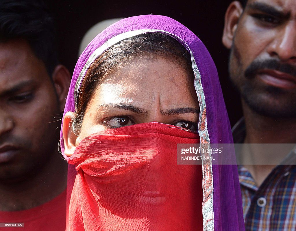 Harbrinder Kaur, 22, an Indian woman that was beaten by the police addresses the media at Usman village near Tarn Taran district about 25 kms (15 miles) from Amritsar on March 6, 2013. Taking serious view of the alleged beating of Kaur by policemen in Punjab's Tarn Taran district, Chief Minister Parkash Singh Badal today ordered a magisterial probe into the incident. The 22-year-old girl and her father were allegedly beaten by policemen when they sought to lodge a complaint against some persons who teased the girl and passed vulgar comments in public. AFP PHOTO/NARINDER NANU