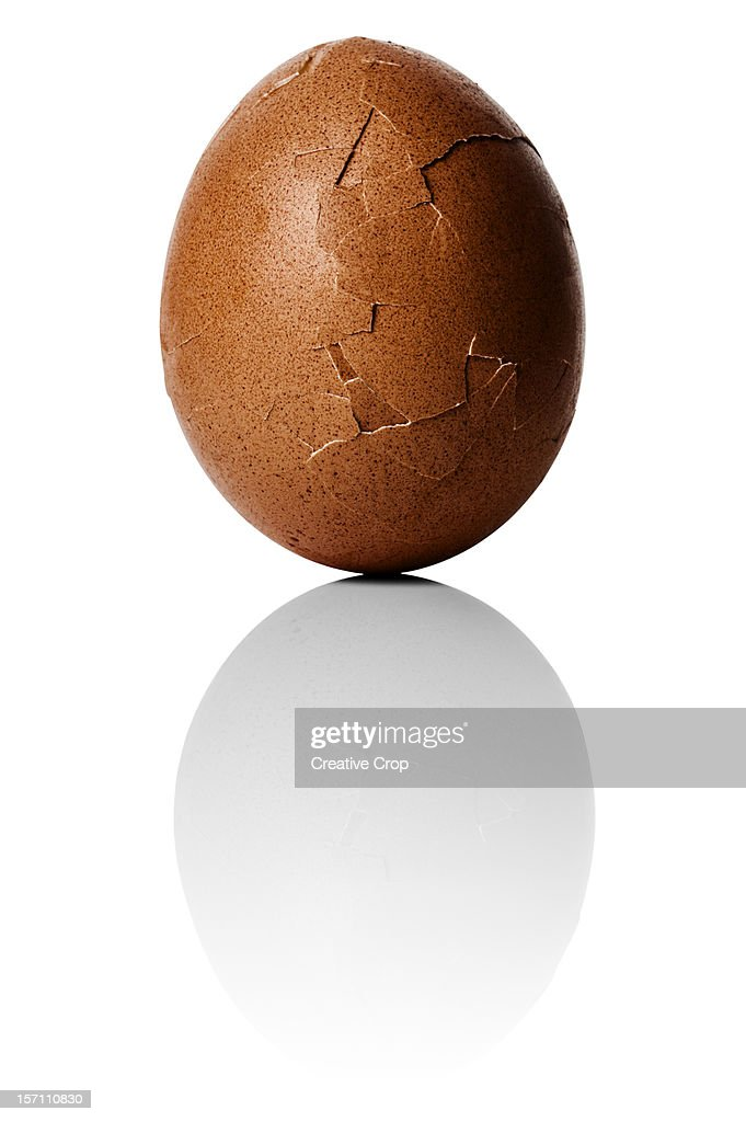Hard boiled chicken egg with shell cracking open : Stock Photo