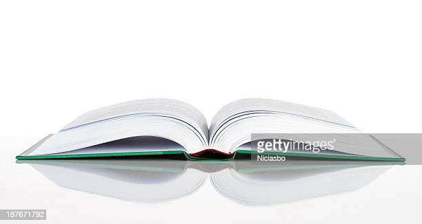 A hard cover book laid open on a white surface