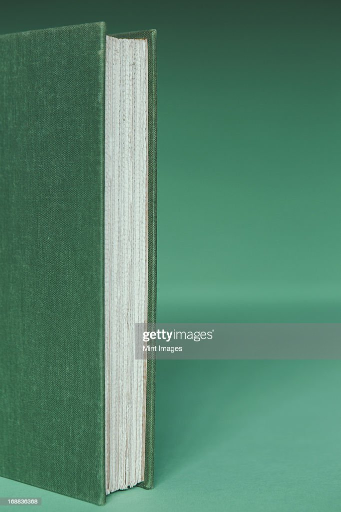 White Book Cover Paper : A hard cover book with green and white paper page