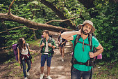 Hard, difficult, tiring and exhausting expedition of four friends in wild forest in trail. Guy is struggling of a neck pain, massaging it