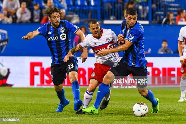 Hard fight between Montreal Impact midfielder Blerim Dzemaili and Toronto FC forward Sebastian Giovinco to gain control of the ball with Montreal...