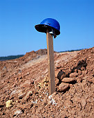 Hard hat on a wooden post