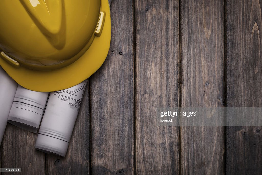 hard hat with blue print on wooden background : Stock Photo