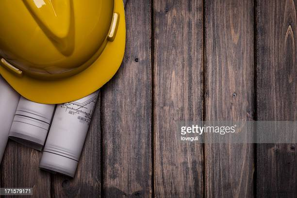 hard hat with blue print on wooden background