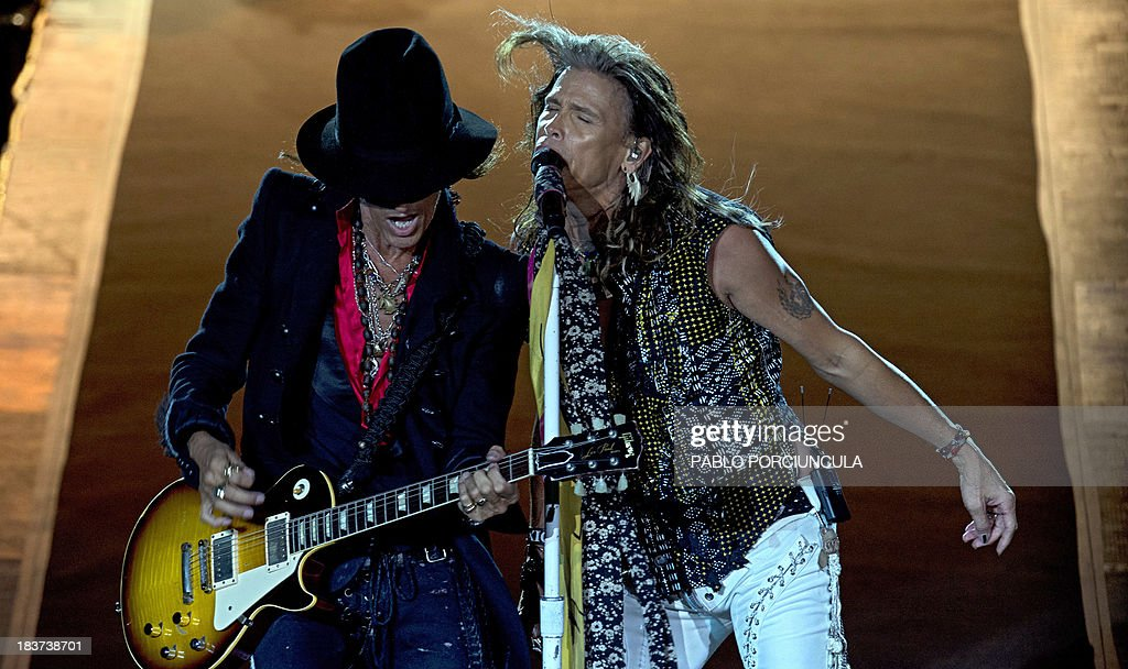 US hard rock band Aerosmith's singer Steve Tyler (R) and guitarist Joe Perry perform at the Centenario stadium in Montevideo on October 9, 2013. AFP PHOTO / Pablo PORCIUNCULA