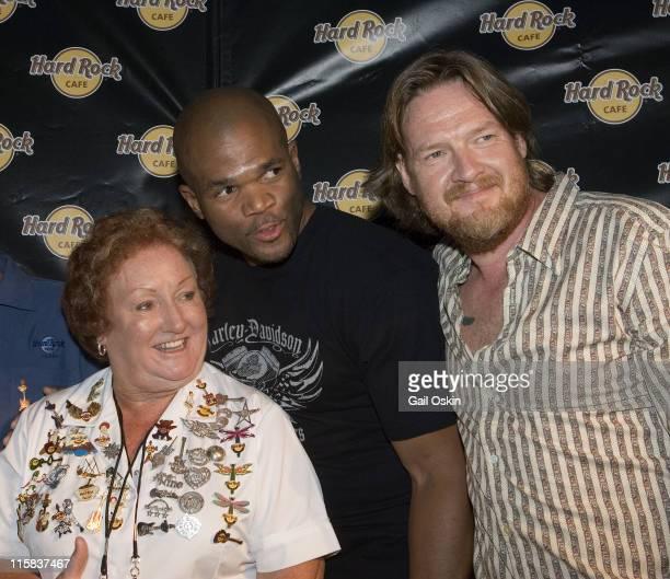 Hard Rock Cafe waitress Rita Gilligan left Darryl 'DMC' McDaniels member of the rap group Run DMC center and actor Donal Logue right at the grand...