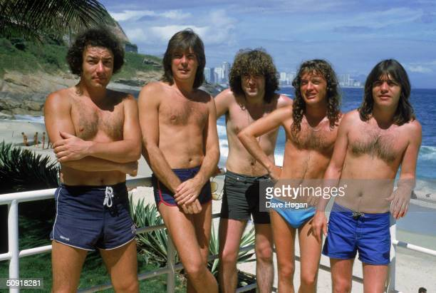 Hard rock group AC/DC at the beach in Ipanema Brazil during a South American tour January 1985 Left to right Brian Johnson Cliff Williams Simon...