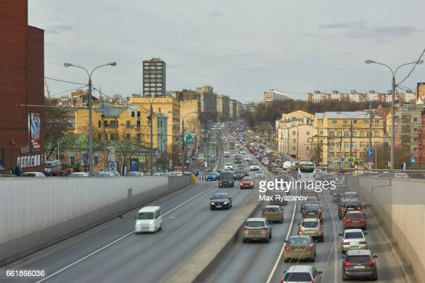 Hard traffic of cars on on a large road in the city in the daytime