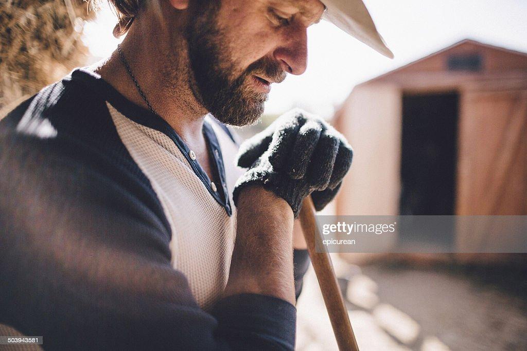 Hard working man takes break from manual labor
