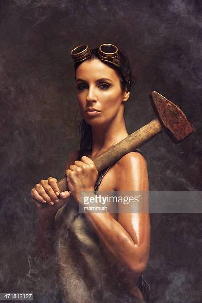 hard working woman holding a big hammer