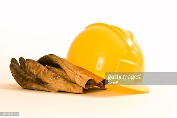 Bauarbeiterhelm und Arbeit Handschuhe