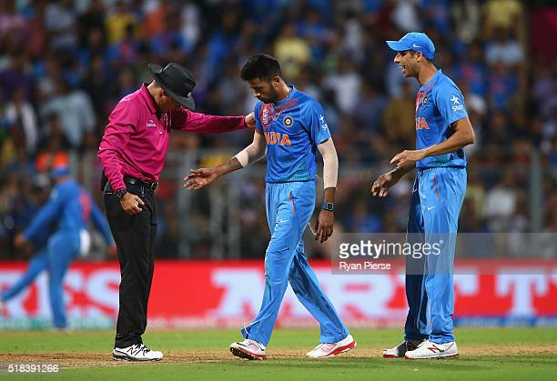 Hardik Pandya of India speaks to Umpire Richard Kettleborough after having Lendl Simmons of the West Indies caught off a no ball during the ICC World...