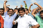 Hardik Patel an organiser of the Patidar community gathers with group members for a rally demanding 'Other Backward Class' status in Ahmedabad on...