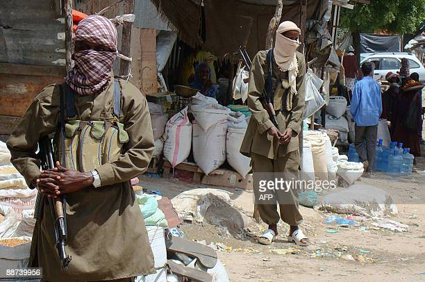 Hardline AlShebab militants patrol in southern Mogadishu�s Bakara market during a raid by the group to find out traders that sell expired food on...