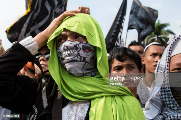 Hardline muslims protest against a new government decree which has allowed the Indonesian government to ban the ultra conservative Islamic group...