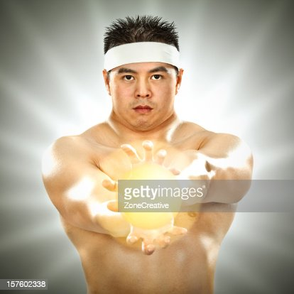 hard-muscled karateka with bright sphere