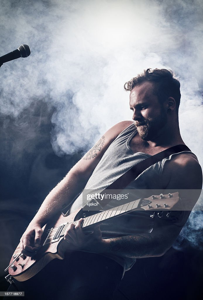 Hardrocker Play Guitar : Stock Photo