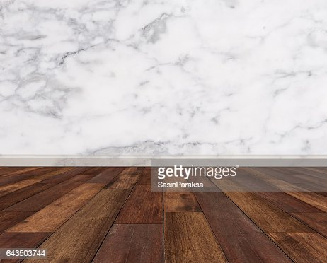 Hardwood floor with white marble wall : Stock Photo