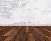 Hardwood floor with white marble wall