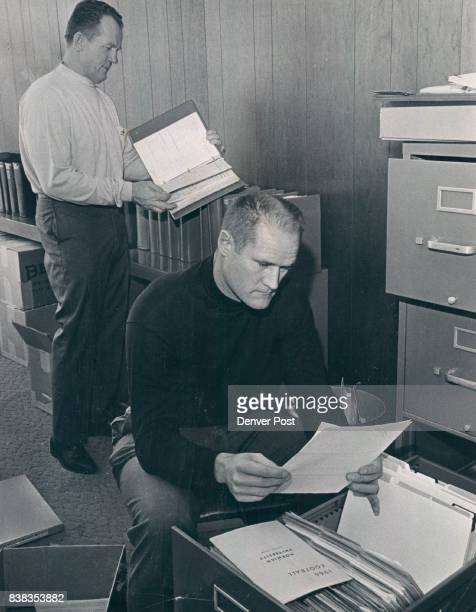 Hardy Carroll Spts file 5p Bronco Staff in New Quarters Fred Gehrke director of player personnel and Carroll Hardy Denver Bronco scout prepare...