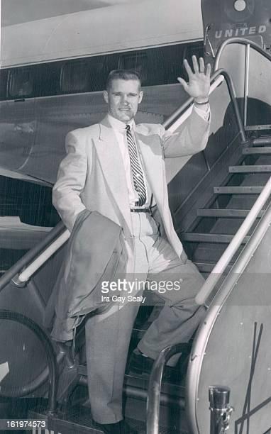 DEC 19 1954 DEC 20 1954 Hardy Carroll spts file 5p Carroll Hardy University of Colorado backfield star boards a plane at Stapleton airfield Sunday...