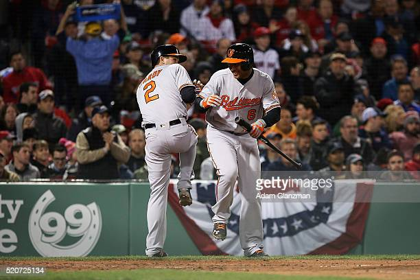 J Hardy celebrates after hitting a 2 run home run in the 4th inning with Jonathan Schoop of the Baltimore Orioles during the game against the Boston...