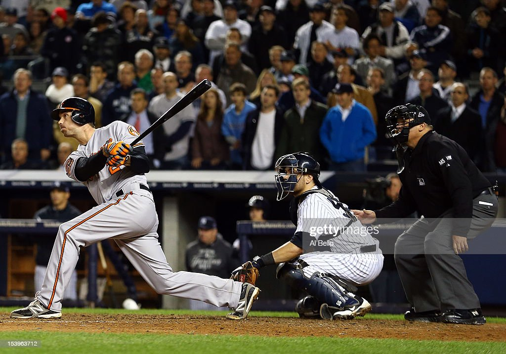 J.J. Hardy #2 of the Baltimore Orioles bats in the game-winning run in the top of the thirteenth inning of Game Four of the American League Division Series against the New York Yankees at Yankee Stadium on October 11, 2012 in the Bronx borough of New York City.