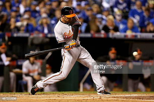 J Hardy of the Baltimore Orioles bats in the second inning against Jeremy Guthrie of the Kansas City Royals during Game Three of the American League...