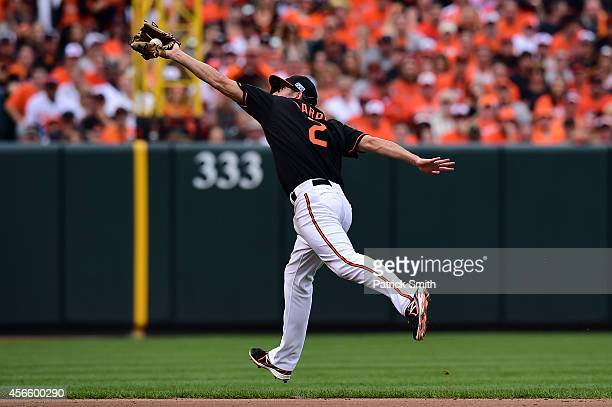 J Hardy of the Baltimore Orioles catches a ball hit Ezequiel Carrera of the Detroit Tigers in the seventh inning during Game Two of the American...