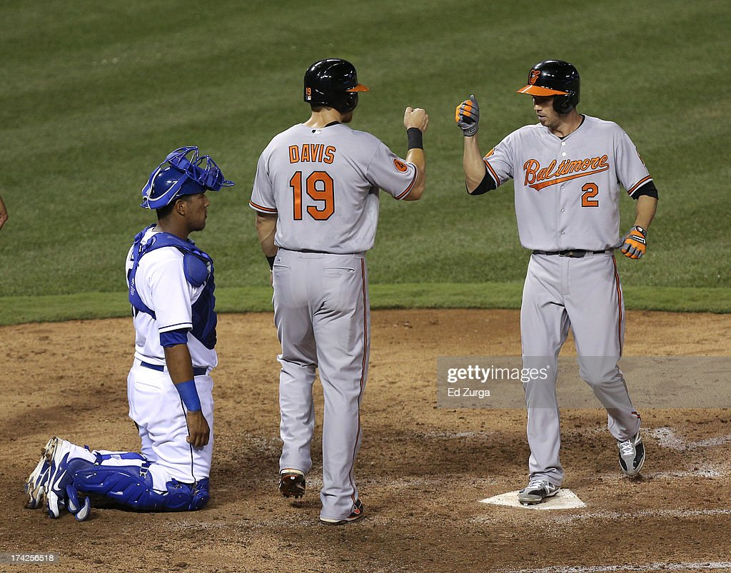 <a gi-track='captionPersonalityLinkClicked' href=/galleries/search?phrase=J.J.+Hardy&family=editorial&specificpeople=216446 ng-click='$event.stopPropagation()'>J.J. Hardy</a> #2 of the Baltimore Orioles celebrates hits two-run home run with Chris Davis #19 in the sixth inning during a game against the Kansas City Royals at Kauffman Stadium on July 22, 2013 in Kansas City, Missouri.