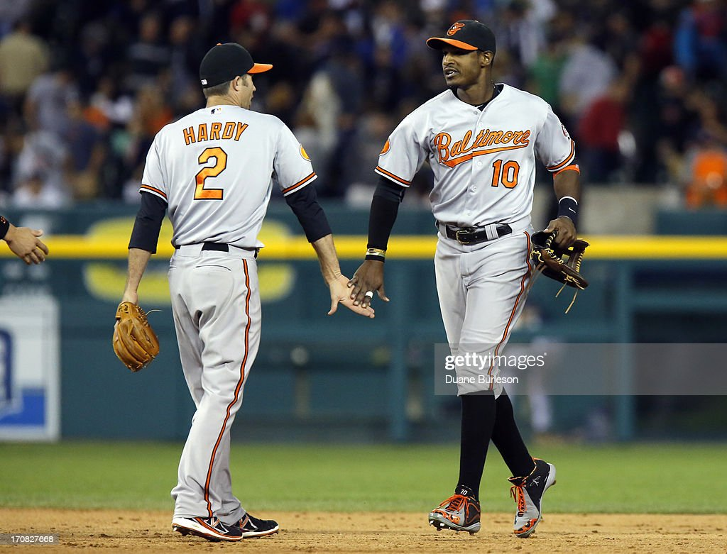 <a gi-track='captionPersonalityLinkClicked' href=/galleries/search?phrase=J.J.+Hardy&family=editorial&specificpeople=216446 ng-click='$event.stopPropagation()'>J.J. Hardy</a> #2 of the Baltimore Orioles celebrates with Adam Jones #10 after a win over the Detroit Tigers at Comerica Park on June 18, 2013 in Detroit, Michigan. Hardy hit a two-run home run and Jones added a three-run home run in a 5-2 win over the Tigers.