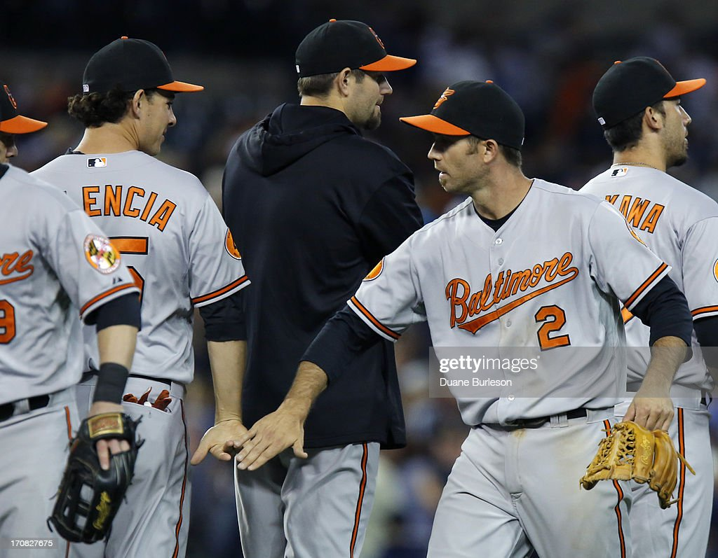<a gi-track='captionPersonalityLinkClicked' href=/galleries/search?phrase=J.J.+Hardy&family=editorial&specificpeople=216446 ng-click='$event.stopPropagation()'>J.J. Hardy</a> #2 of the Baltimore Orioles celebrates with <a gi-track='captionPersonalityLinkClicked' href=/galleries/search?phrase=Danny+Valencia&family=editorial&specificpeople=5443820 ng-click='$event.stopPropagation()'>Danny Valencia</a> #35 after a 5-2 win over the Detroit Tigers at Comerica Park on June 18, 2013 in Detroit, Michigan.