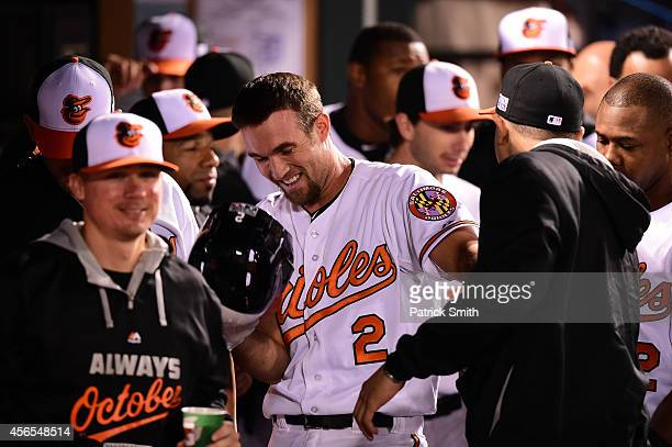 J Hardy of the Baltimore Orioles celebrates with his teammates after hitting a solo home run in the seventh inning against Max Scherzer of the...
