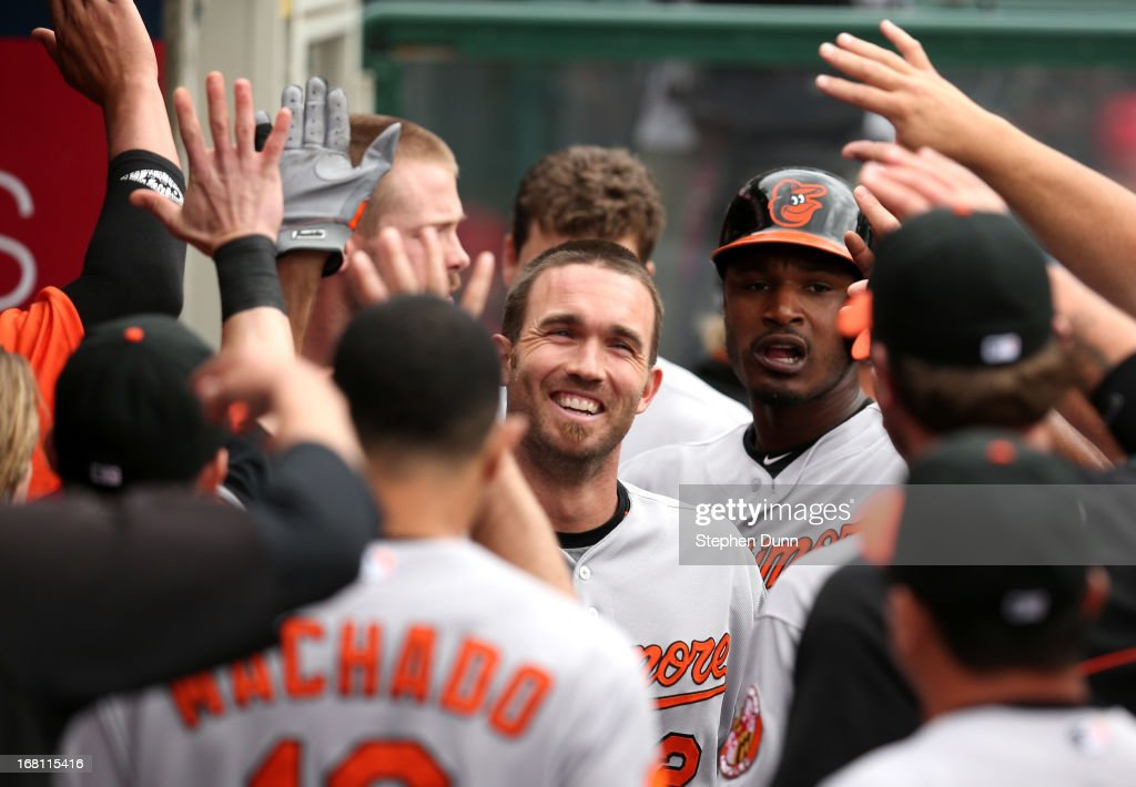 <a gi-track='captionPersonalityLinkClicked' href=/galleries/search?phrase=J.J.+Hardy&family=editorial&specificpeople=216446 ng-click='$event.stopPropagation()'>J.J. Hardy</a> #2 of the Baltimore Orioles celebrates with teammates in the dugout after hitting a two run home run in the fourth inning against the Los Angeles Angels of Anaheim at Angel Stadium of Anaheim on May 5, 2013 in Anaheim, California.