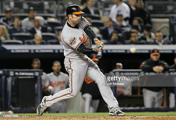 J Hardy of the Baltimore Orioles connects on a fifth inning double against the New York Yankees at Yankee Stadium on May 2 2012 in the Bronx borough...