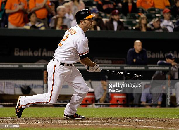 J Hardy of the Baltimore Orioles follows his game winning two RBI single against the Seattle Mariners during the twelfth inning at Oriole Park at...