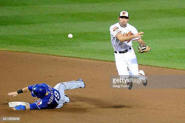 J Hardy of the Baltimore Orioles forces out Dan Robertson of the Texas Rangers to start a double play in the fifth inning at Oriole Park at Camden...