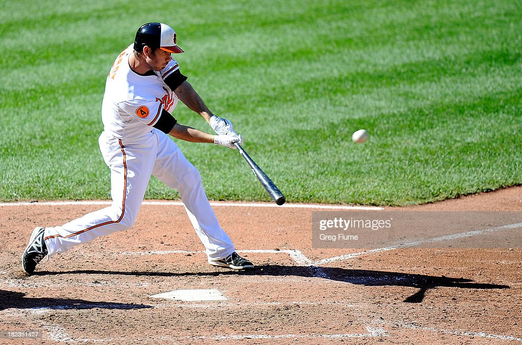 <a gi-track='captionPersonalityLinkClicked' href=/galleries/search?phrase=J.J.+Hardy&family=editorial&specificpeople=216446 ng-click='$event.stopPropagation()'>J.J. Hardy</a> #2 of the Baltimore Orioles hits a double in the fifth inning against the Boston Red Sox at Oriole Park at Camden Yards on September 29, 2013 in Baltimore, Maryland. Baltimore won the game 7-6.