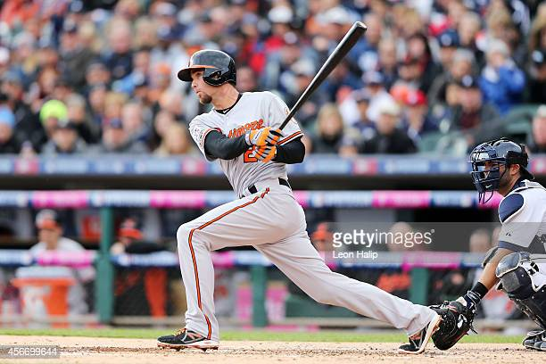 J Hardy of the Baltimore Orioles hits a single in the second inning against the Detroit Tigers during Game Three of the American League Division...
