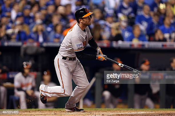 J Hardy of the Baltimore Orioles hits an RBI double to right field to score Steve Pearce in the second inning against Jeremy Guthrie of the Kansas...