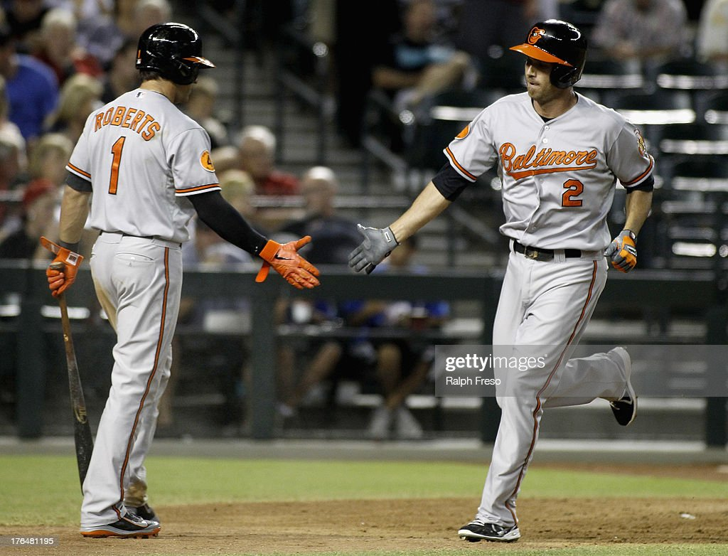 <a gi-track='captionPersonalityLinkClicked' href=/galleries/search?phrase=J.J.+Hardy&family=editorial&specificpeople=216446 ng-click='$event.stopPropagation()'>J.J. Hardy</a> #2 of the Baltimore Orioles is congratulated by teammate Brian Roberts #1 after his solo home run against the Arizona Diamondbacks during the fifth inning of a MLB game at Chase Field on August 13, 2013 in Phoenix, Arizona.