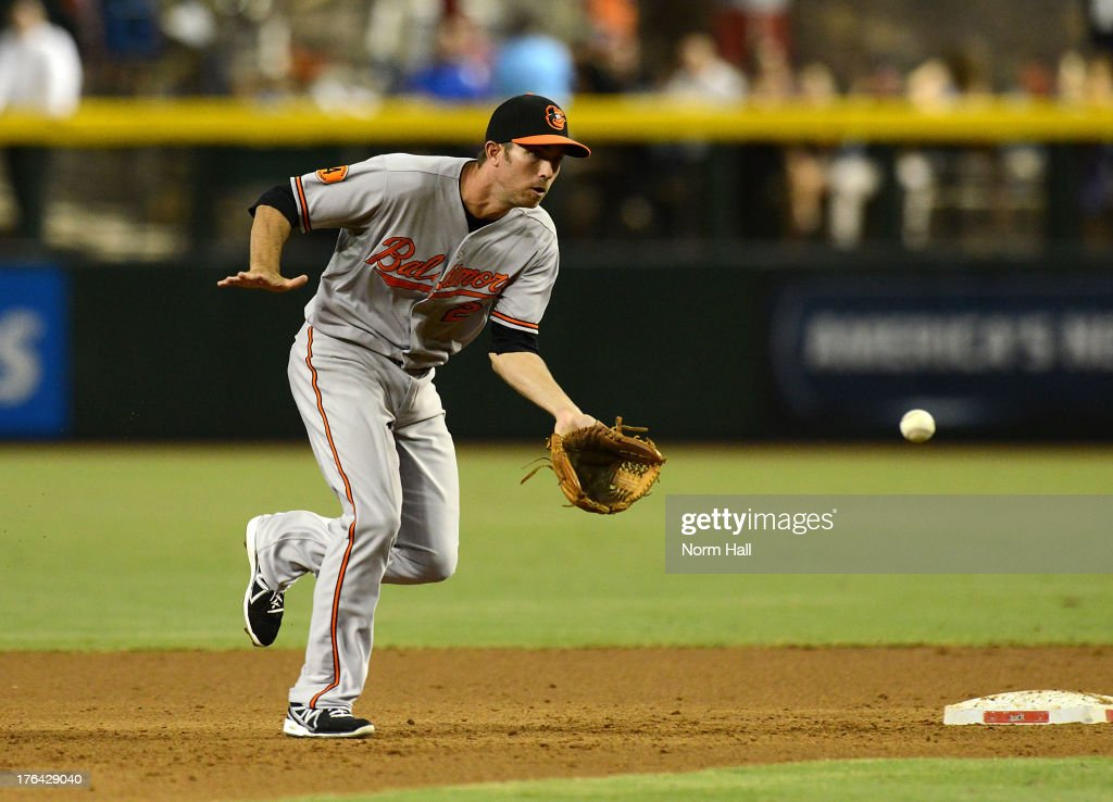 JJ Hardy #2 of the Baltimore Orioles makes a play on a ground ball against the Arizona Diamondbacks at Chase Field on August 12, 2013 in Phoenix, Arizona.
