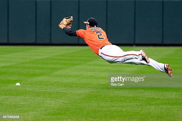 J Hardy of the Baltimore Orioles misses a ball hit by Eric Hosmer of the Kansas City Royals single to left field scoring Norichika Aoki and Lorenzo...