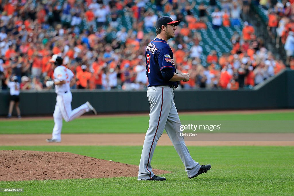 <a gi-track='captionPersonalityLinkClicked' href=/galleries/search?phrase=J.J.+Hardy&family=editorial&specificpeople=216446 ng-click='$event.stopPropagation()'>J.J. Hardy</a> #2 of the Baltimore Orioles rounds the bases after hitting a grand slam off of pitcher <a gi-track='captionPersonalityLinkClicked' href=/galleries/search?phrase=Anthony+Swarzak&family=editorial&specificpeople=5758737 ng-click='$event.stopPropagation()'>Anthony Swarzak</a> #51 of the Minnesota Twins during the sixth inning at Oriole Park at Camden Yards on August 31, 2014 in Baltimore, Maryland.