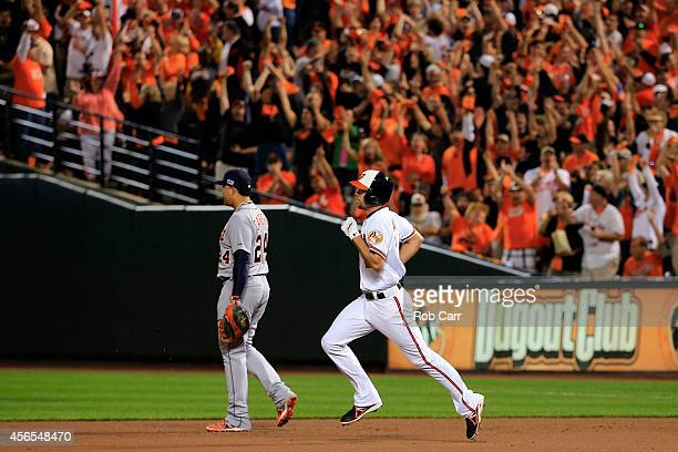 J Hardy of the Baltimore Orioles rounds the bases passing Miguel Cabrera of the Detroit Tigers after hitting a solo home run in the seventh inning...