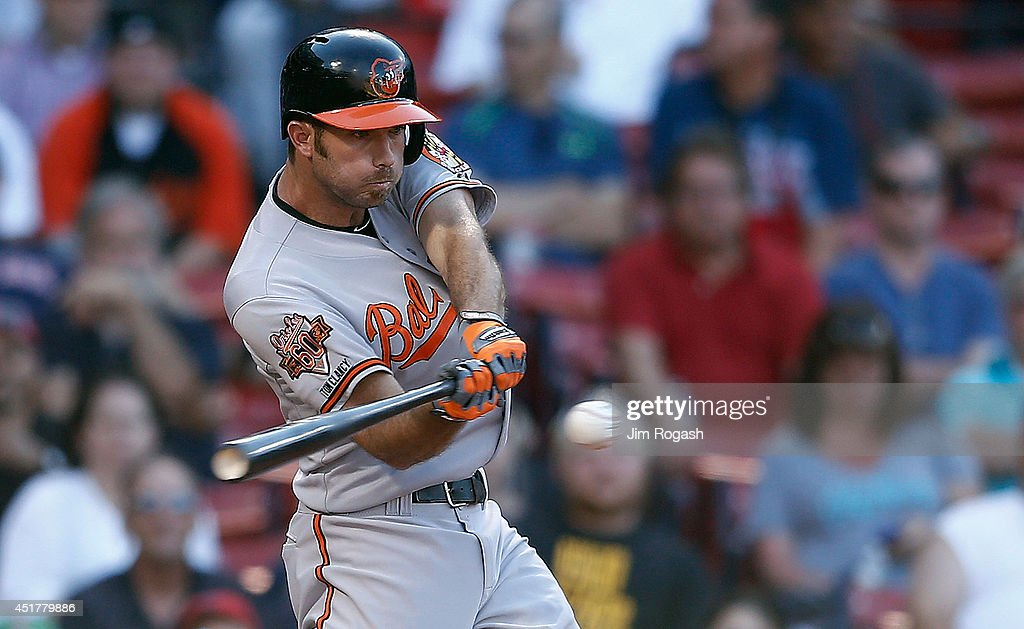 <a gi-track='captionPersonalityLinkClicked' href=/galleries/search?phrase=J.J.+Hardy&family=editorial&specificpeople=216446 ng-click='$event.stopPropagation()'>J.J. Hardy</a> #2 of the Baltimore Orioles singles in the winning run in the 12th inning against the Boston Red Sox at Fenway Park on July 6, 2014 in Boston, Massachusetts.