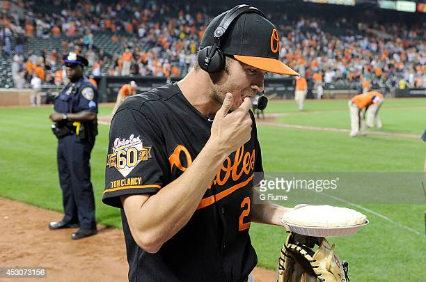 J Hardy of the Baltimore Orioles tastes a pie during an interview after a victory against the Seattle Mariners at Oriole Park at Camden Yards on...