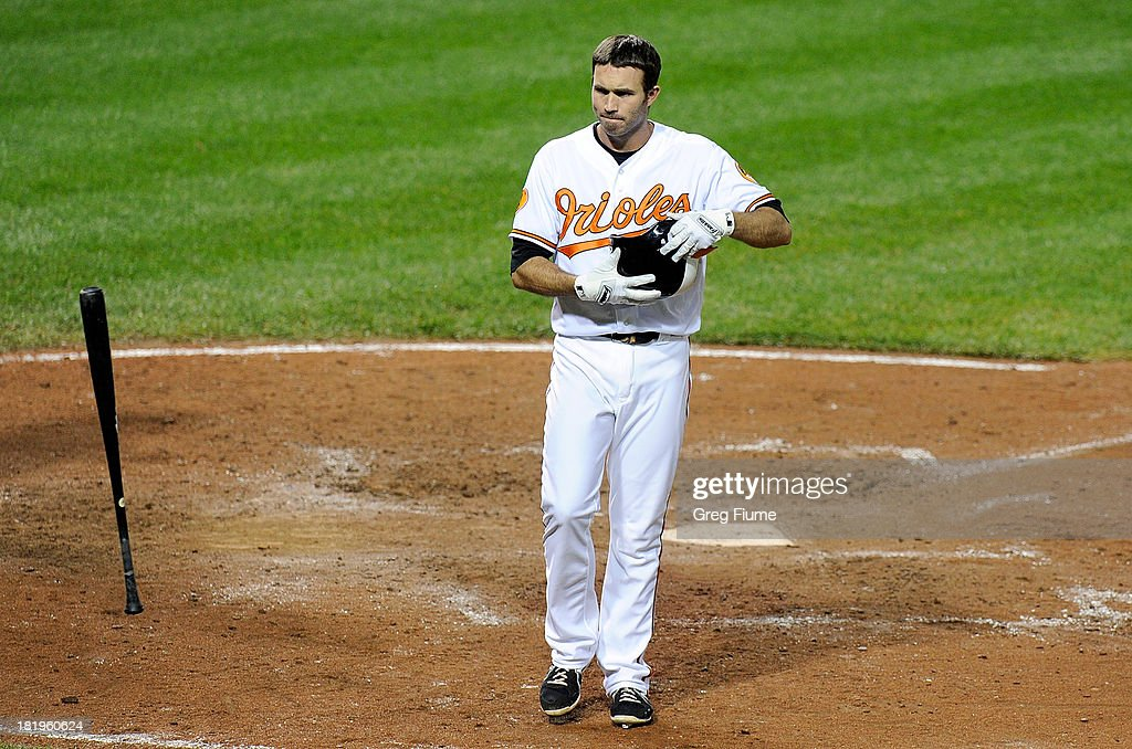 <a gi-track='captionPersonalityLinkClicked' href=/galleries/search?phrase=J.J.+Hardy&family=editorial&specificpeople=216446 ng-click='$event.stopPropagation()'>J.J. Hardy</a> #2 of the Baltimore Orioles tosses his bat after striking out to end the sixth inning against the Toronto Blue Jays at Oriole Park at Camden Yards on September 26, 2013 in Baltimore, Maryland.